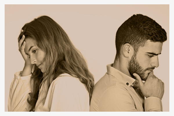 Young mixed-race couple having ralationship problems isolated on white background